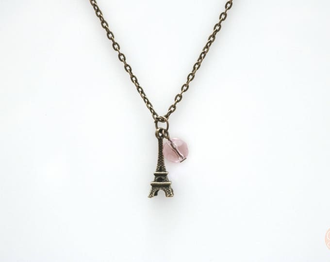 Eiffel tower necklace with pink feature bead.