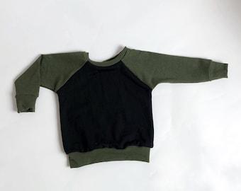 Green and black raglan sweatshirt