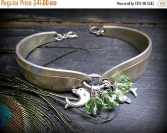 SALE The Boto Spoon Bracelet. Antique Silverplate Double spoons with dolphins & celery green crystals. boho mythology cuff
