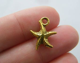 8 Starfish charms antique gold tone GC73