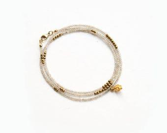 Shimmering Gemstone Wrap Bracelet with Tiny Gold Skull Charm