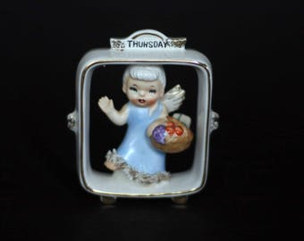 vintage lefton thursday's child figurine