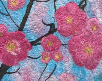 A Cherry Blossom art quilt. A silk painting, delicate pink against blue sky,