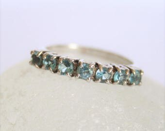 Blue topaz and sterling silver ring. US size 7 1/4. UK size O