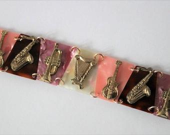 Musical instruments bracelet. Vintage lucite bracelet.  Vintage jewellery