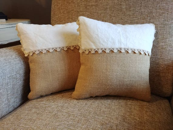 decorative pair of pillows featuring burlap and vintage dresser scarf