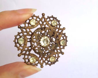 Edwardian snowflake style brass & rhinestone brooch / Victorian 1900s 19th century metal paste stone pin