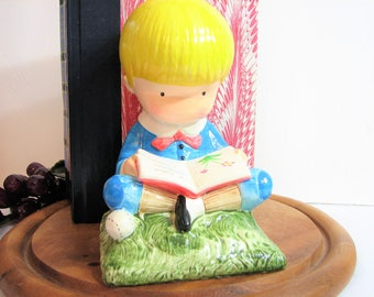 Joan Walsh Anglund Blonde Little Boy Sitting and Reading Ceramic Figurine, Bookend, 1972, Baseball and Frog at his side, Boys Room Decor