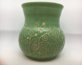 Green vase with sgraffito design