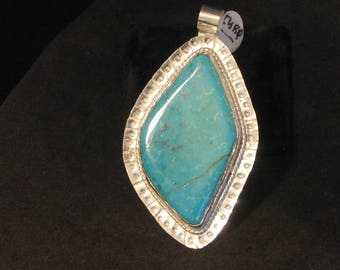 Turquoise free form Pendent set in Silver