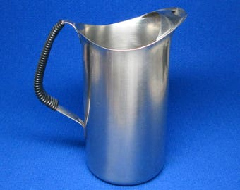WMF Cromargan Germany stainless steel pitcher with wrapped handle .