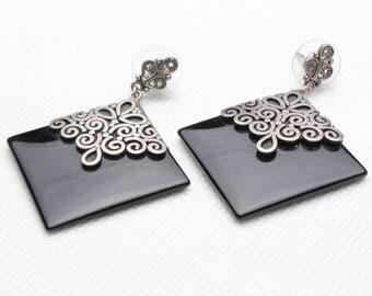 Vintage onyx and sterling earrings .