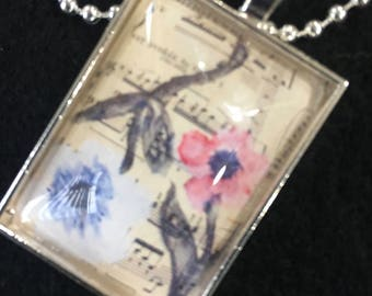 Flowers & Music - a 35mm x 25mm rectangle silver pendant.