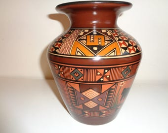 Vintage South American Folk Art Style Cusco Vase signed and  painted by The Artist COPARI in Peru with great lines and design in Great Shape