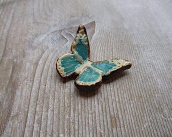 Rustic Browns and Oranges Aqua Butterfly pendant pottery pendant