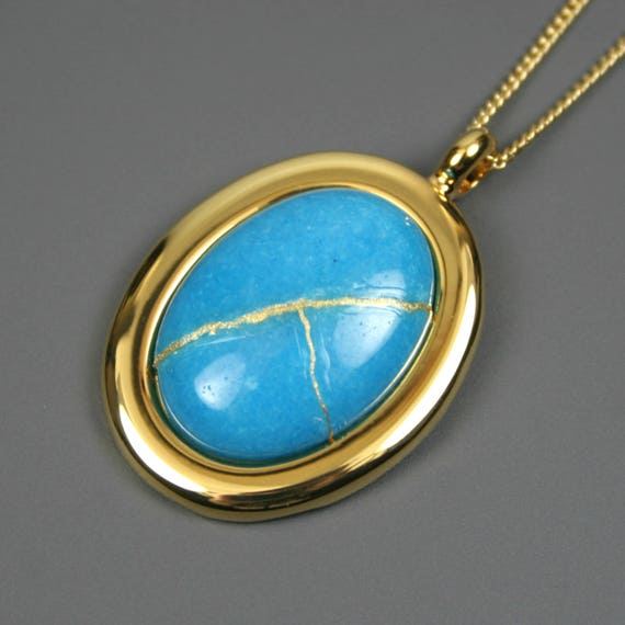 Kintsugi (kintsukuroi) turquoise blue dolomite stone cabochon with gold repair in a gold plated setting on gold chain - OOAK