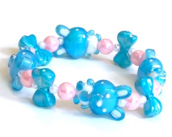 Pastel Blue Iridescent Bunny and Bow Stretch Bracelet with Pink and White Pearl Beads