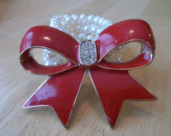3 Row White Pearl Stretch Cuff Bracelet with a Big Red Bow and Clear Rhinestones
