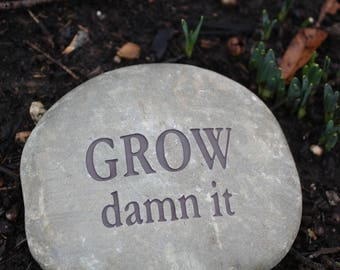 Grow Damn It engraved stone