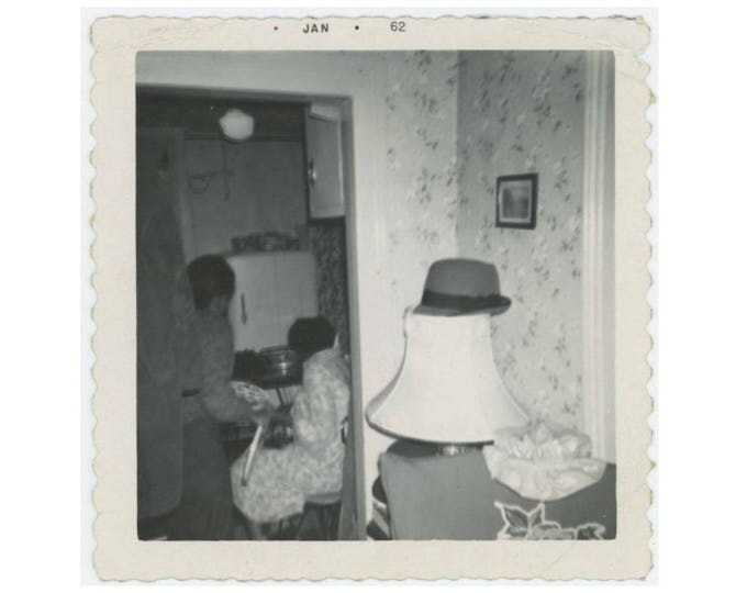 Vintage Snapshot Photo: Hat on Lamp, 1962 (77592)