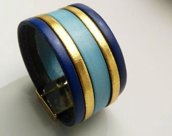 cobalt leather cuff gold and sky with clasp gold