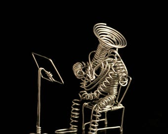 Deluxe Tuba Player seated with music stand