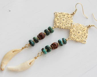 long dangle coyote tooth earrings with turquoise