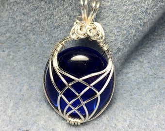 """Beautiful Deep Blue Glass Pendant with Celtic Wire Weave, it is symbolic of friendship, affection, harmony and love  1 1/2"""" long"""