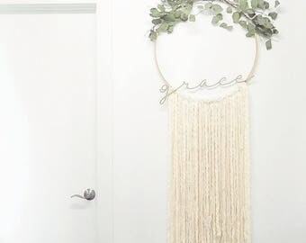 Boho wall hanging with eucalyptus and wooden grace cutout