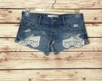 Vintage distressed blue jean denim shorts