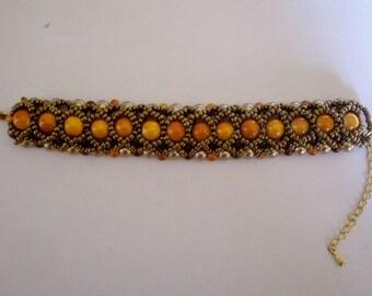 Bracelet in pearls brown glass orange