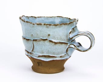 Red Stoneware and Blue Mug