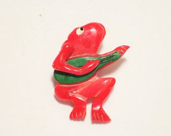 Carved Red Bakelite Figural Frog Brooch Playing Guitar With Movable Arm