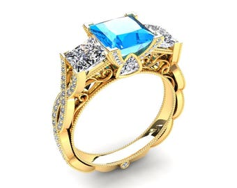 1.00 Carat Princess Cut Blue Topaz And Moissanite Three Stone Ring In 14k or 18k Yellow Gold CF22BU2Y