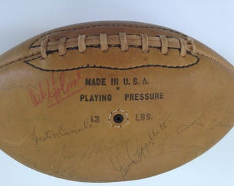 Boston Patriots autographed  Rawlings Football1960s team Mike Holovak. Gino Capaletti, Jim Nance signed