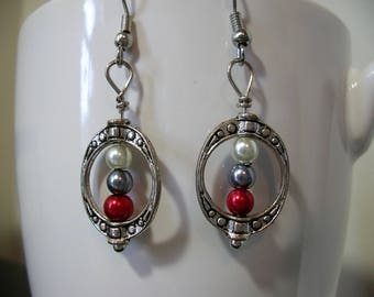 Red, gray, and white earrings