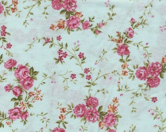 Cotton fabric wreaths of roses on turquoise background