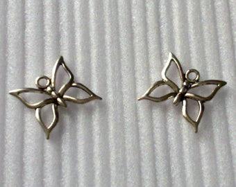 2 pendants form butterflies size 1.9 cm.  silver color.