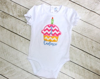 First birthday cupcake shirt Girls rainbow birthday shirt Baby girl birthday one piece with cupcake candles name and number Birthday shirt
