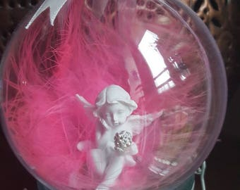 Beautiful angel ornament with pink feathers inside a large baubles hanging decoration