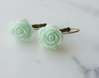 Earrings, mint green resin rose brass dangle earrings