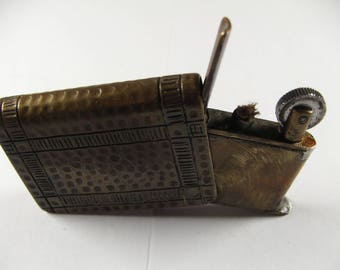 A nice old vintage Trench Art WW1 lighter in the shape of a book brass petrol