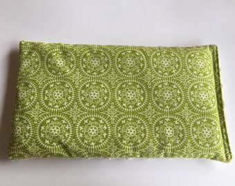 Green and cream patterned heat pack filled with Australian wheat.