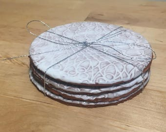 Set of Four White Lace Coasters
