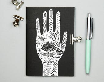 Folk art A6 notebook, monochrome hand illustration, black and white tattoo design, hand of fatima