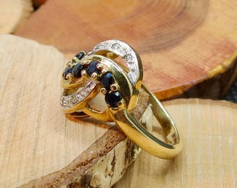 A vintage 9k yellow gold ring with sapphires and diamonds.