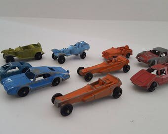 Vintage lot of early 1960's Tootsietoy and Midgetoy metal cars, nine total cars one price, chippy paint.