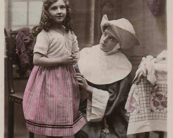 Unusual Vintage postcard. Little girl with nun. Parlour. Photograph. B&F?