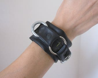 Black bracelet made of recycled material, man or woman