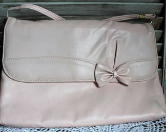 Vintage. Light pink. Handbag with a cute bow. Long strap. 1980's.